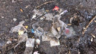 drug packets near a bench along the blackburn with darwen canal