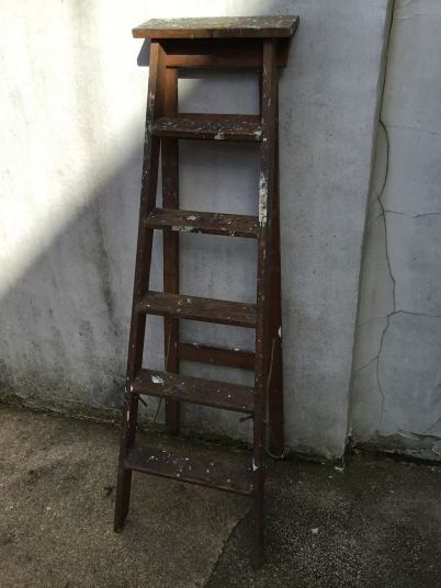 Old wooden ladders due to be thrown